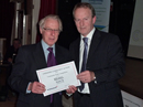 Presentation of 'Best Kept Village' award 2012 (runner-up, 2500-5000 population) to Noel Dutton, representing Kelsall Parish Council, at the awards ceremony in Middlewich Civic Hall on 4th October 2012. Click for bigger image.